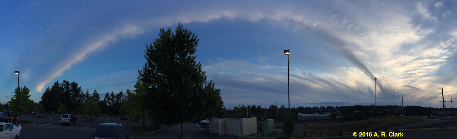 panoramic view of cloud vortex streaming out of a storm.